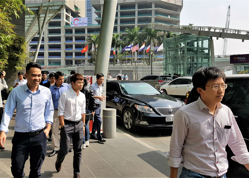 Office workers going for lunch in business district close to Lotte Centre