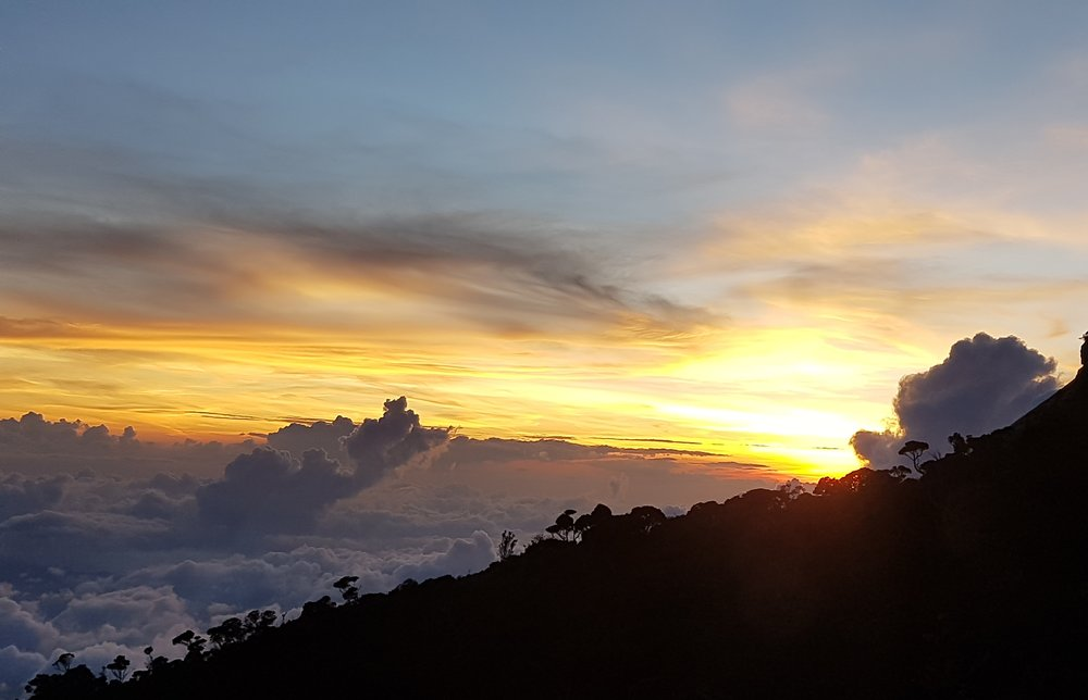 Sunset from the base camp. I was above the clouds.