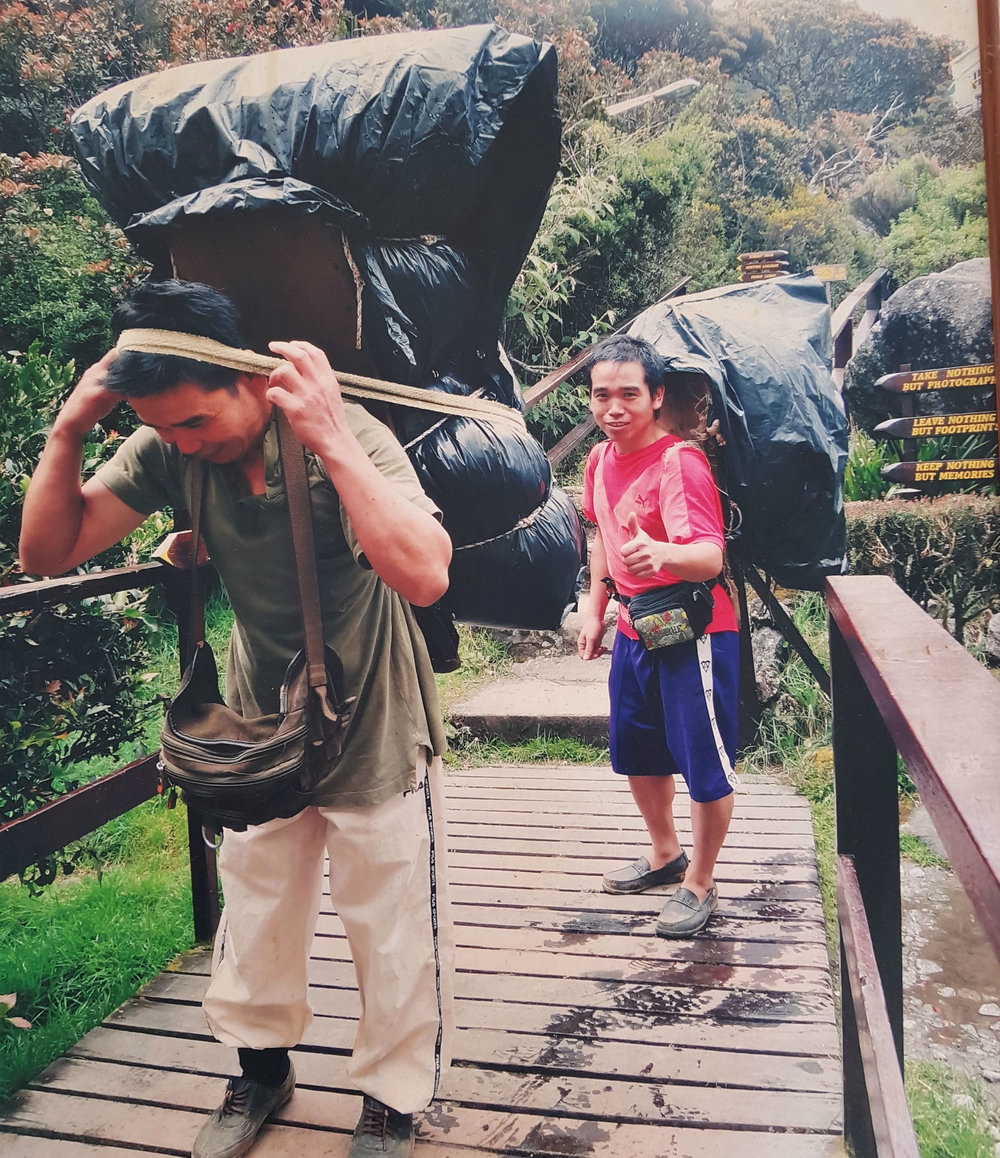 Porters carrying supplies to the base camp