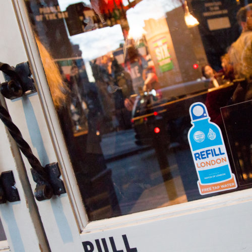 A refill sticker displayed in a shop in London