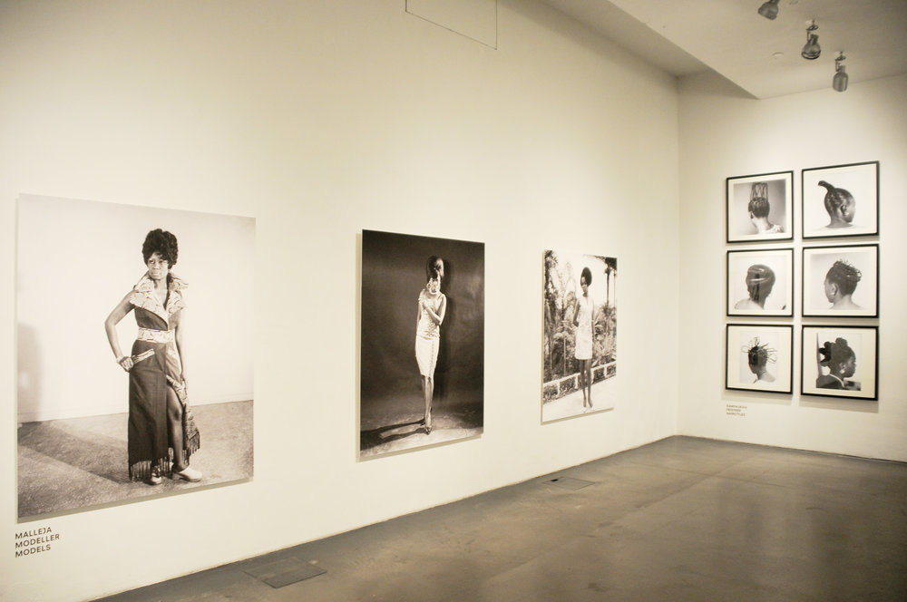 Installation view of  .D Okhai Ojeikere: Moments of Beauty , at Museum of Contemporary Art, Kiasma, 2011.  Above: Photo courtesy African Digital Art.