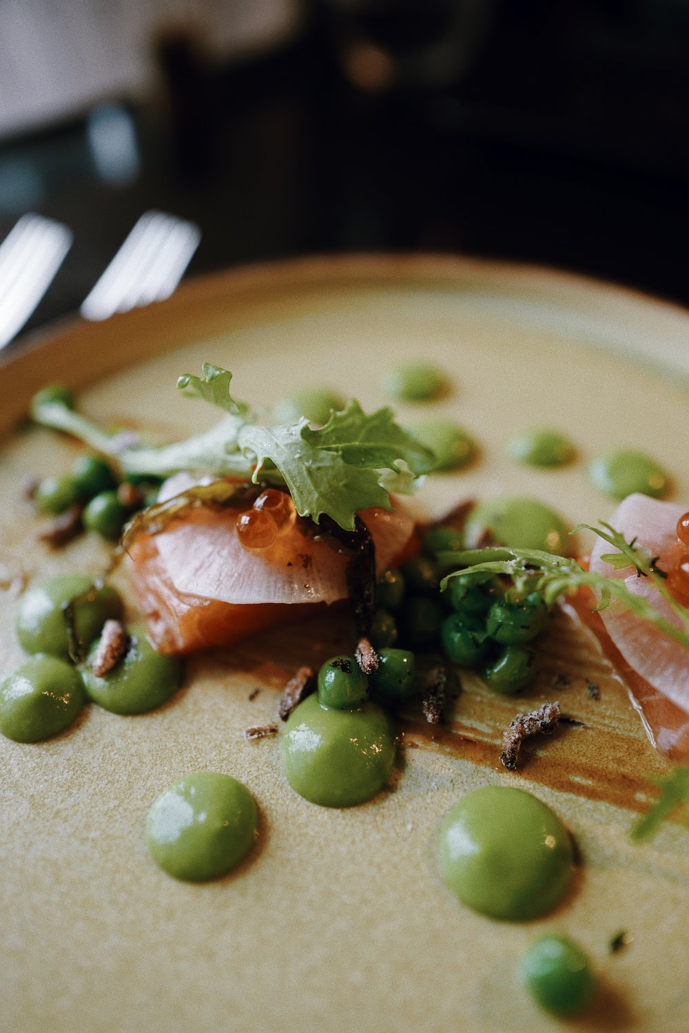 Slow cooked wester ross salmon. Wasabi and pea puree - pickled sea lettuce - miso caramel.