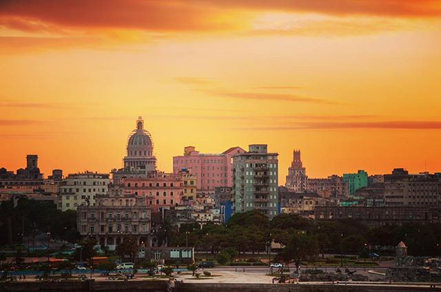 As the sun sets over Havana, the night comes to life. The days can be hot in Cuba which makes night life favorable on a summer day. Music, dance, and laughter fill the streets from locals and tourists coming together to enjoy this magnificent and friendly country. My goodness do I love Cuba. At Travel by Tropical we want to share our love for this country and the people with everyone, the little piece of Heaven with minimal technology. Where you can live in the moment, REALLY in the moment.  #cuba #havana #love #capitol #culture #cultures #history #travel #travelphotography #photo #photography #sunset #sunsets #city #cityscape #cityview #view #views #viewpoint #travelling #travels #color #colorful