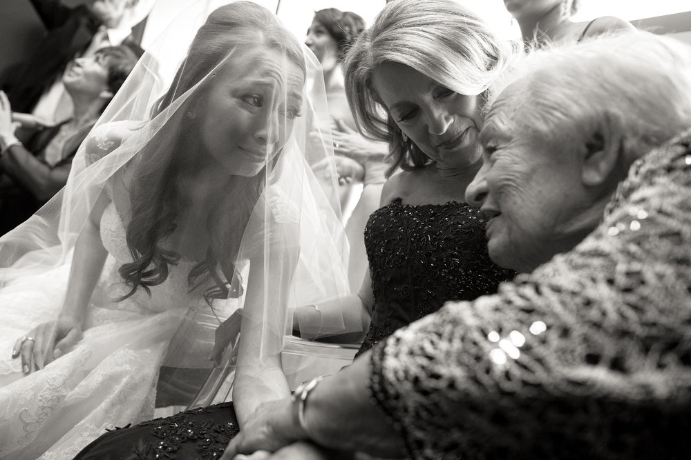 Melissa and her grandmother embrace during her bedekken ceremony with her mother in the middle.
