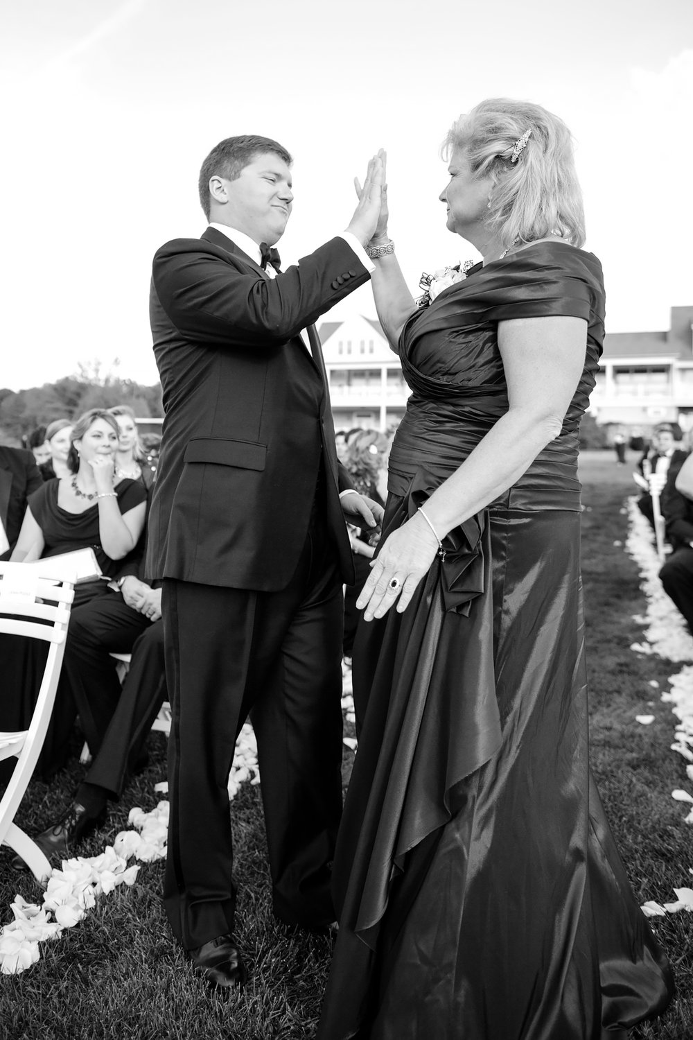 Dan gives is mother a high five after he walks him down the aisle.