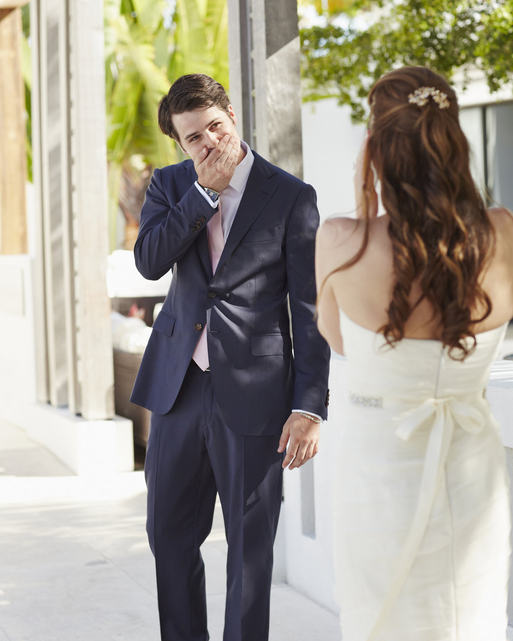 Alex with genuine surprise happiness her his and and Emily's wedding in Turks and Caicos