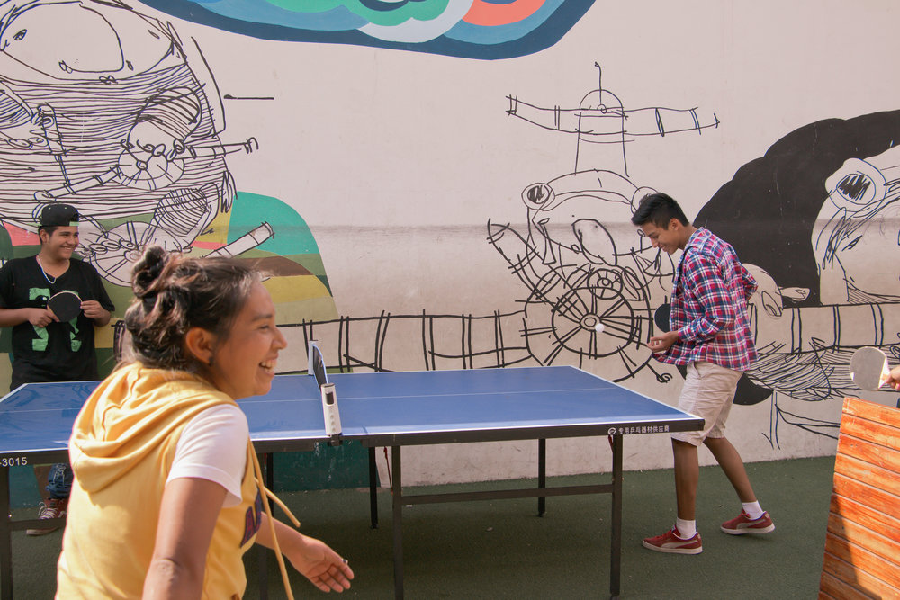 GARY GARCIA TAKES A BREAK FROM PAINTING THE SCHOOL AND PLAYS PINGPONG WITH HIS PEERS AT LOS PATOJOS IN JOCOTENANGO, GUATEMALA ON JAN. 18. THE STAFF AT LOS PATOJOS ARE A TIGHT KNIT GROUP, DOING MOST EVERYTHING TOGETHER, WHETHER IT BE WORK OR PLAY.