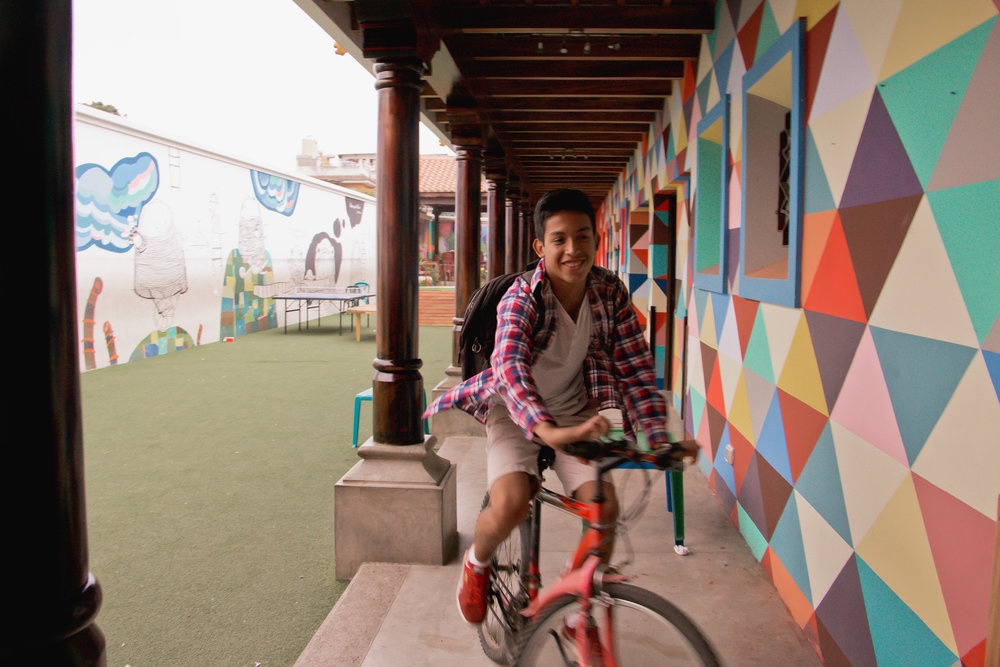 GARY GARCIA BEGINS TO HEAD HOME AFTER A LONGDAY AT LOS PATOJOS ON JAN. 17 IN JOCOTENANGO, GUATEMALA. MOST STAFF MEMBERS AT ALOS PATOJOS GREW UP IN JOCOTENANGO AND WALK OR BIKE TO SCHOOL EVERY DAY.