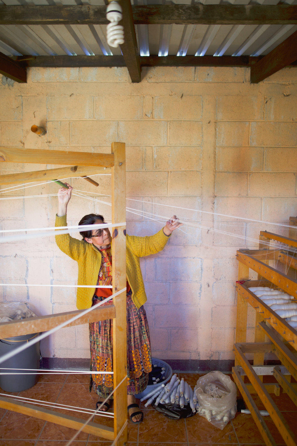 LIDIA SERECH CUTZAL SEPARATES AND ORDERS HER THREADS PREPARING TO WEAVING IN COMALAPA, GUATEMALA ON JAN. 12. SERECH WOVE HER FIRST TABLECLOTH WHEN SHE WAS 8 YEARS OLD.