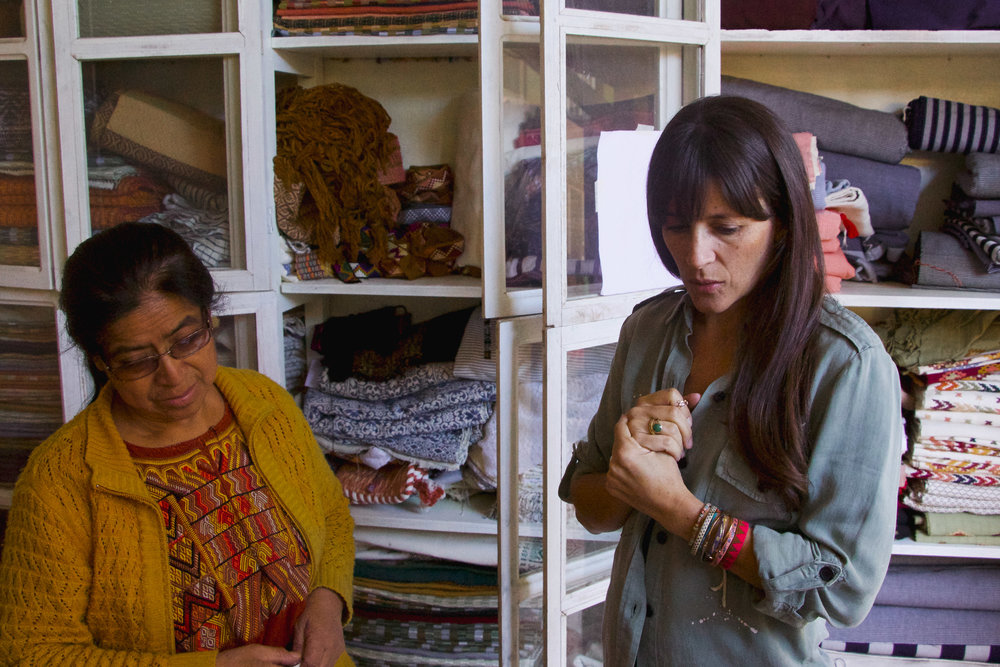 "MOLLY BERRY, OWNER OF LUNA ZORRO, COLLABORATES WITH LIDIA SERECH CUTZAL TO DISCUSS FUTURE TEXTILE IDEAS AT SEREACH'S WORKSHOP IN COMALAPA, GUATEMALA ON JAN. 12. ""I NEVER HAVE TO WONDER IF LIDIA'S CREATIONS WILL FALL APART,"" BERRY SAYS."