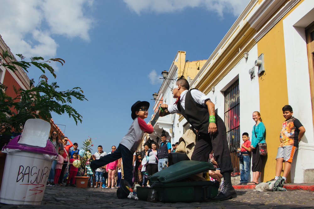 JUAN ESTUARDO TACEN PEREZ INTERACTS WITH HIS CROWD ON 5A AVENIDA NORTE IN ANTIGUA, GUATEMALA JAN. 7. DURING THE WEEK, TACEN SPENDS HIS TIME TRAINING FOR THESE PERFORMANCES BY PRACTICING SCRIPTS, LISTENING TO MUSIC AND LOOKING AT CLOWN VIDEOS ON YOUTUBE.