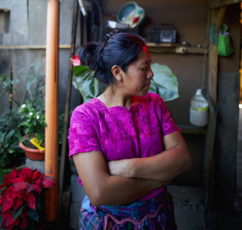 ESMIDA MAIDE MARTINEZ LISTENS TO HER MOTHER SHARE THEIR FAMILY'S TEXTILE TRADITIONS IN SAN ANTONIO, GUATEMALA ON JAN. 9.