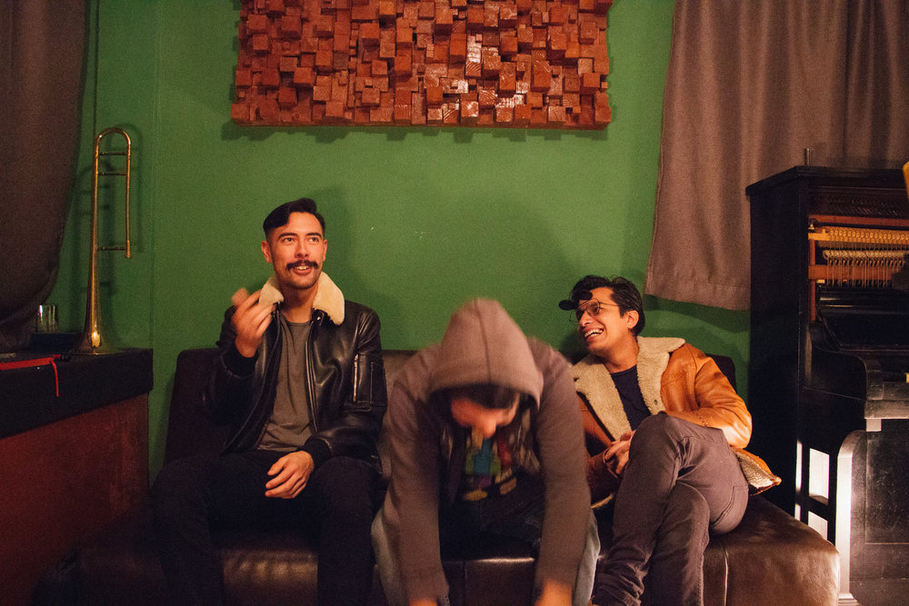 MUSICIAN SEBASTIÁN VILLATORO AND PRODUCERS DAVID SUÁREZ AND FRANC CASTILLEJOS LAUGH AT AN INSIDE JOKE DURING AN INTERVIEW ON JAN. 12 AT RECORDING STUDIO ANÁLOGO DIGITAL. THE THREE OF THEM WORKED TOGETHER TO FINISH RECORDING A SONG.