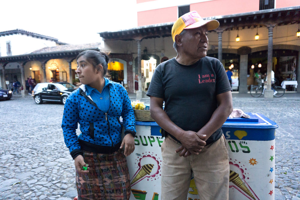 ONE OF TOMAS LOPEZ'S FOUR DAUGHTERS TAKES A BREAK AT HIS ICE CREAM CART IN CENTRAL PARK OF ANTIGUA, GUATEMALA ON JAN. 15. LOPEZ'S ENTIRE FAMILY, HIS WIFE, FOUR DAUGHTERS, AND ONE SON HAS WORKED AT CENTRAL PARK SELLING CANDY AND CIGARETTES.