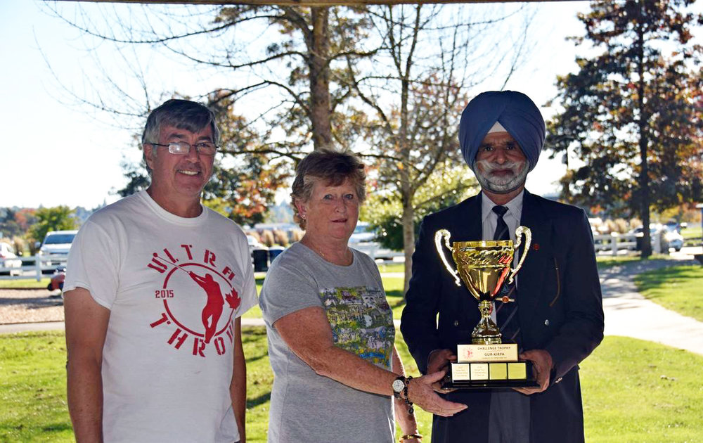 Last year's recipient, Rose Hare presents Harnek Toor with the Challenge Trophy. Left is Club president, Dave McDonald. (Photo: Owen Wong)