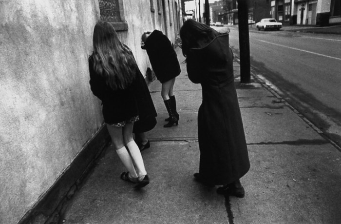 MARK COHEN Untitled (Girls Flinching and Hiding Faces), 1972
