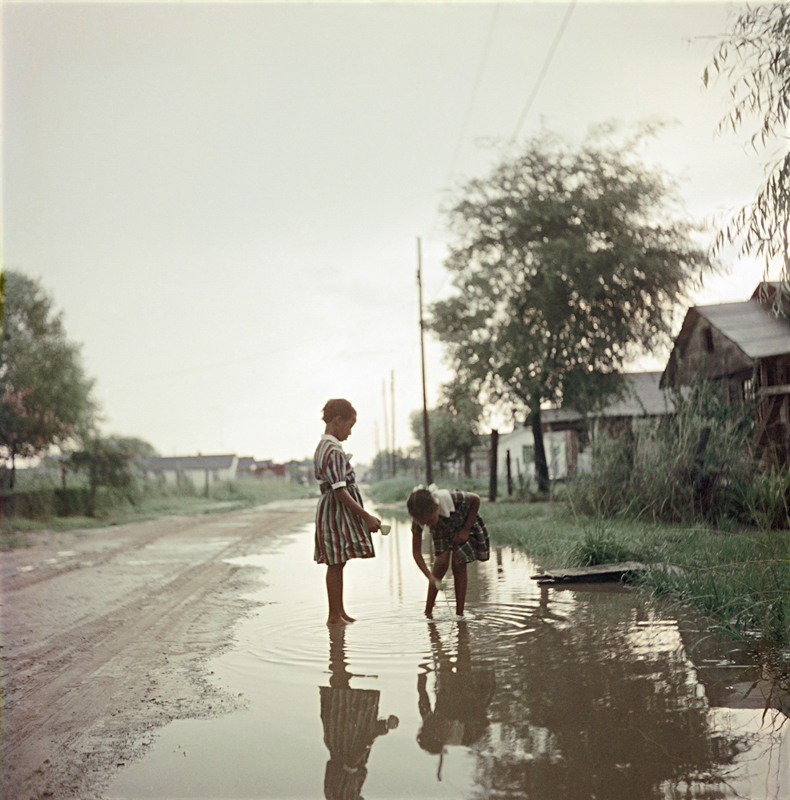 GORDON PARKS,  Untitled  (Two Girls in Puddle), Alabama, 1956                                                                                                                      © The Gordon Parks Foundation