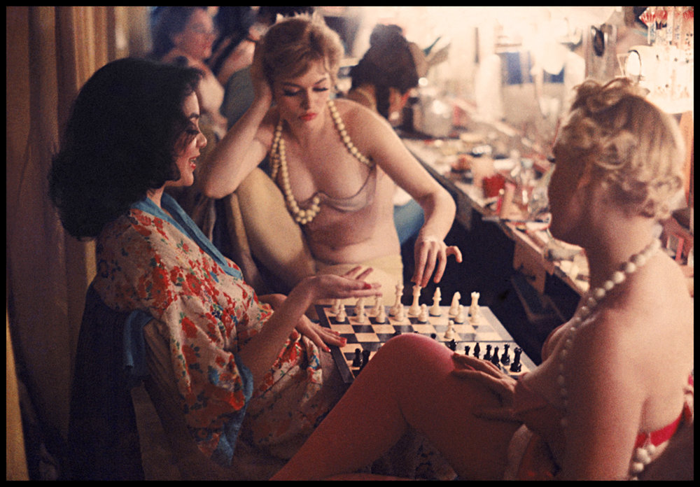 GORDON PARKS,  Showgirls Play Chess Backstage at the Latin Quarter Nightclub , 1958 © The Gordon Parks Foundation
