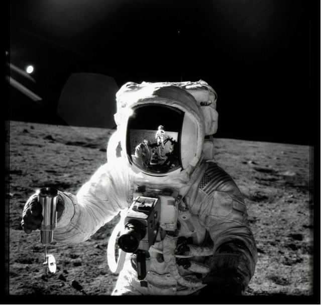 MICHAEL LIGHT 069 Alan Bean Holding Lunar Soil Sample Container at Sharp Crater; Photographed by Charles Conrad, Apollo 12, November 14-24, 1969