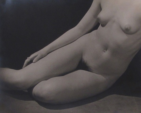 MAN RAY,  Female nude  (supine), 1929