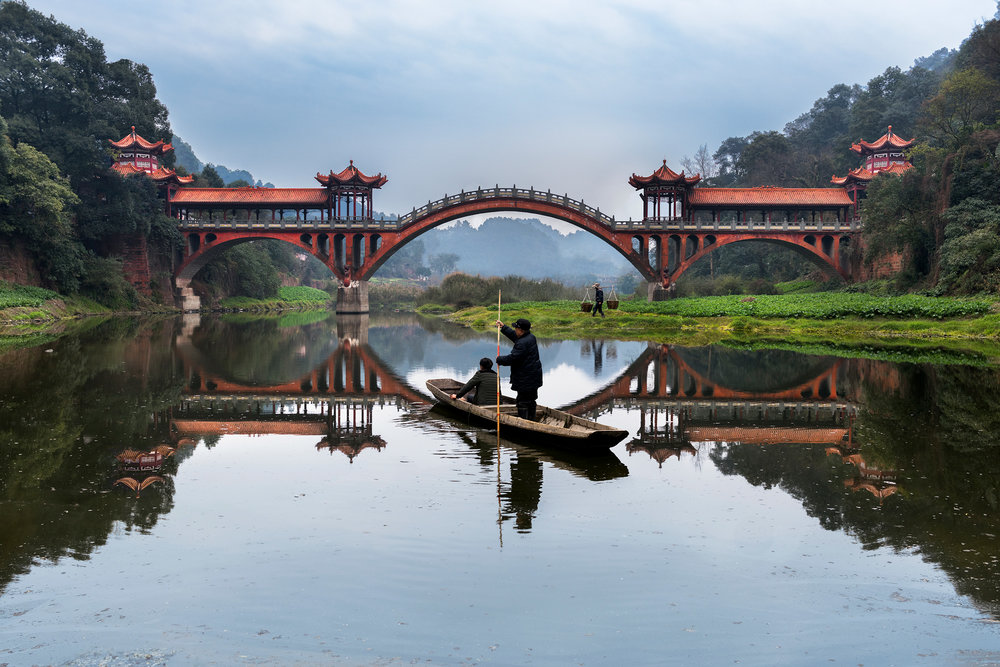 STEVE MCCURRY,  Man Rows on Min River, Leshan, China,  2016