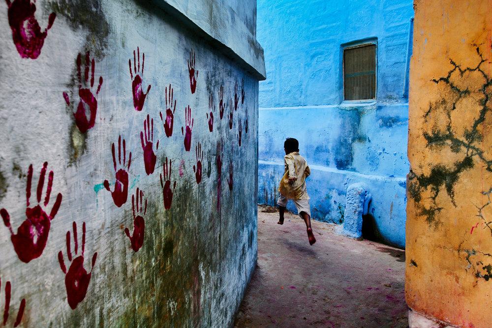 STEVE MCCURRY,  Boy in Mid Flight ,  Jodhpur, Rajasthan, India,  2007
