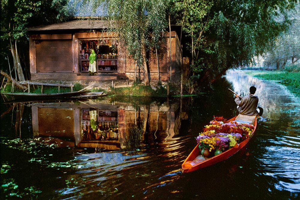 STEVE MCCURRY,  Flower Seller on Dal Lake, Kashmir,  1999