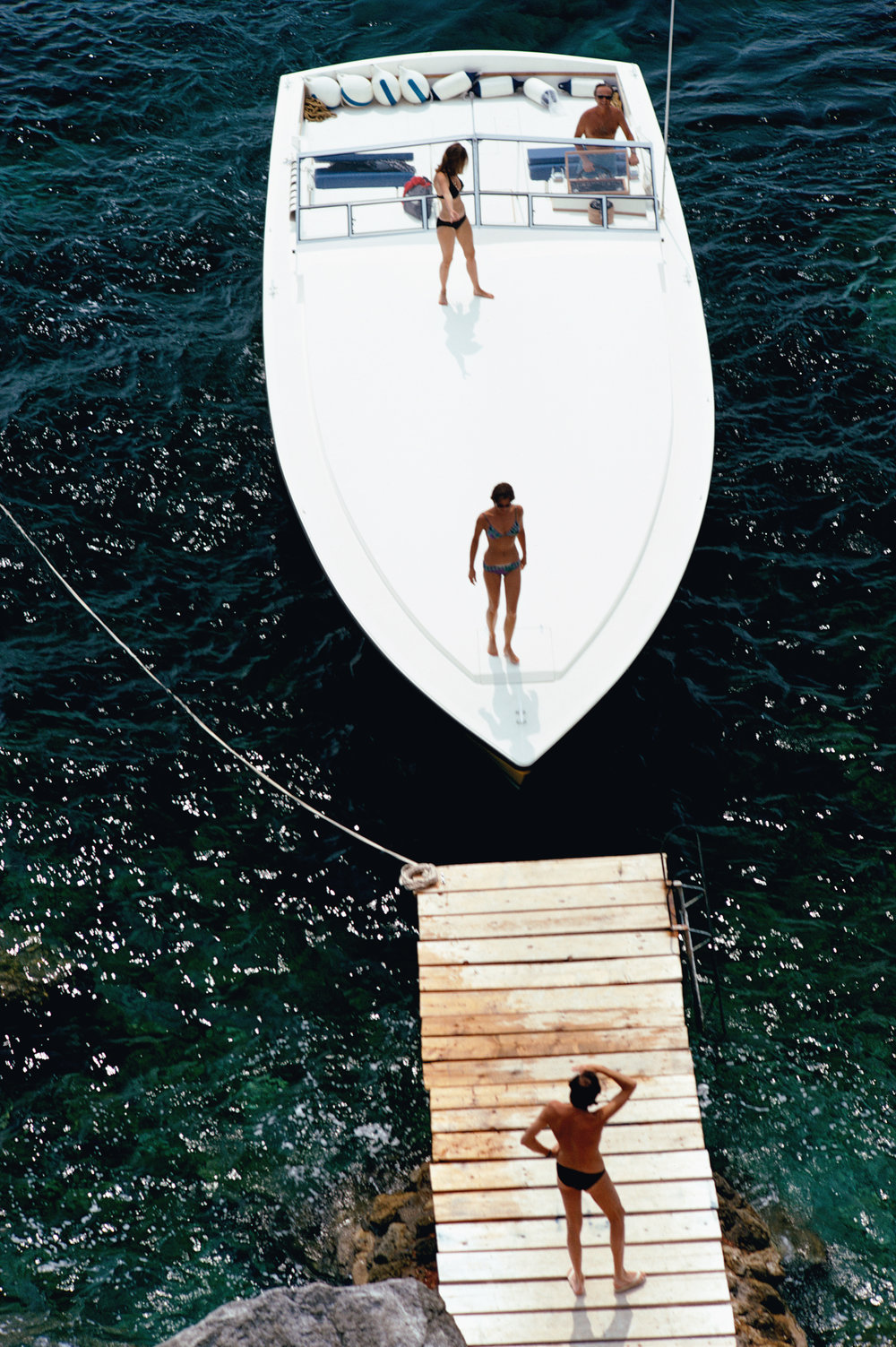 SLIM AARONS,  Speedboat Landing,  1973, courtesy Getty Image Archive