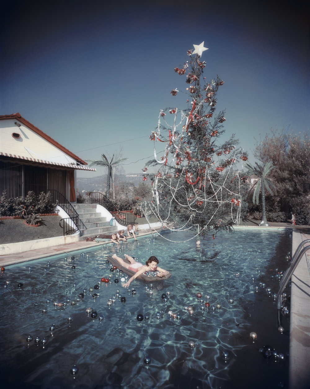 SLIM AARONS,  Christmas Swim , 1954, courtesy Getty Image Archive