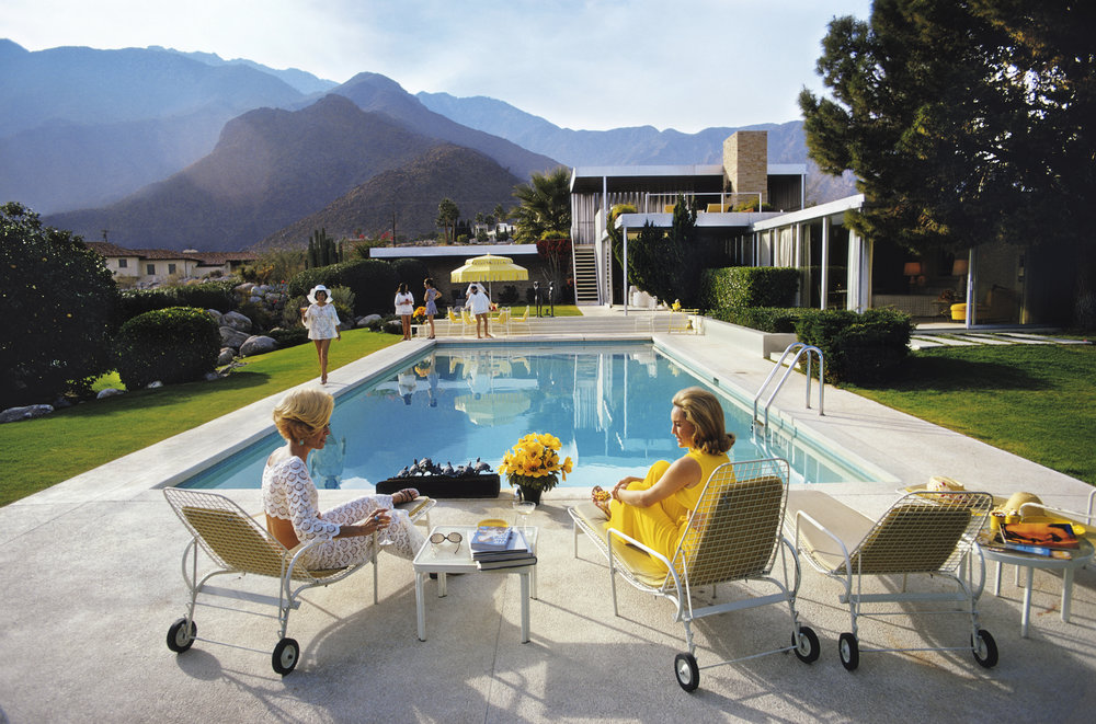 SLIM AARONS,  Pool Gossip , 1970, courtesy Getty Image Archive