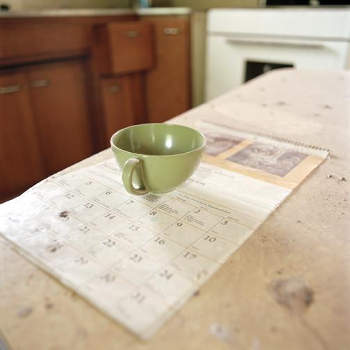 WENDY BURTON,  Interior #19 (Cup/Calendar) , Langdon, North Dakota (from the series Empty Houses), 2004