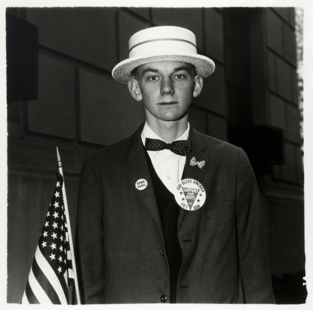 DIANE ARBUS,  Boy with Straw Hat Waiting to March in Pro-War parade,  New York City