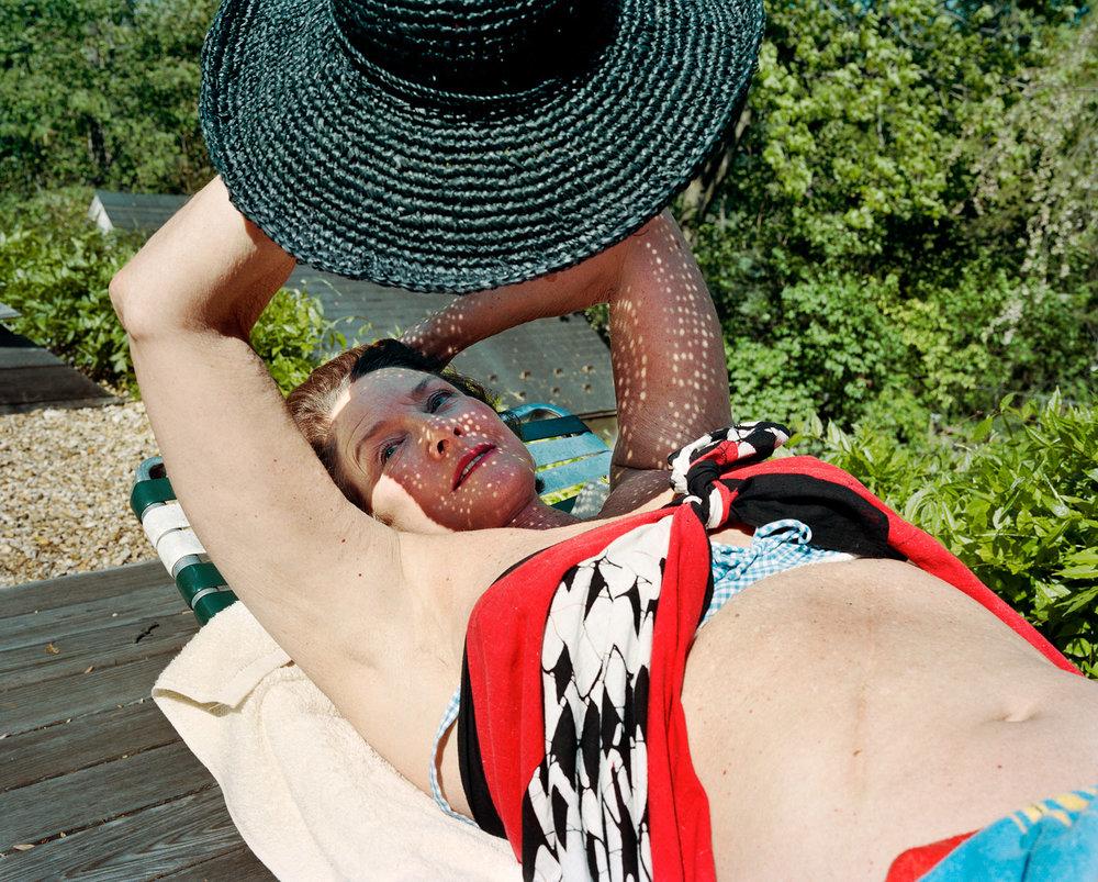 SAGE SOHIER,  Sunbathing on the roof deck, Washington, D.C.,  2003