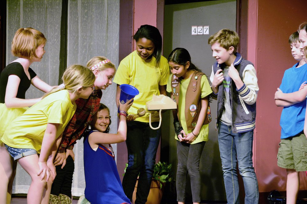 A group of middle school aged students participate in a theater day camp through Parish Summer in Dallas, Texas.