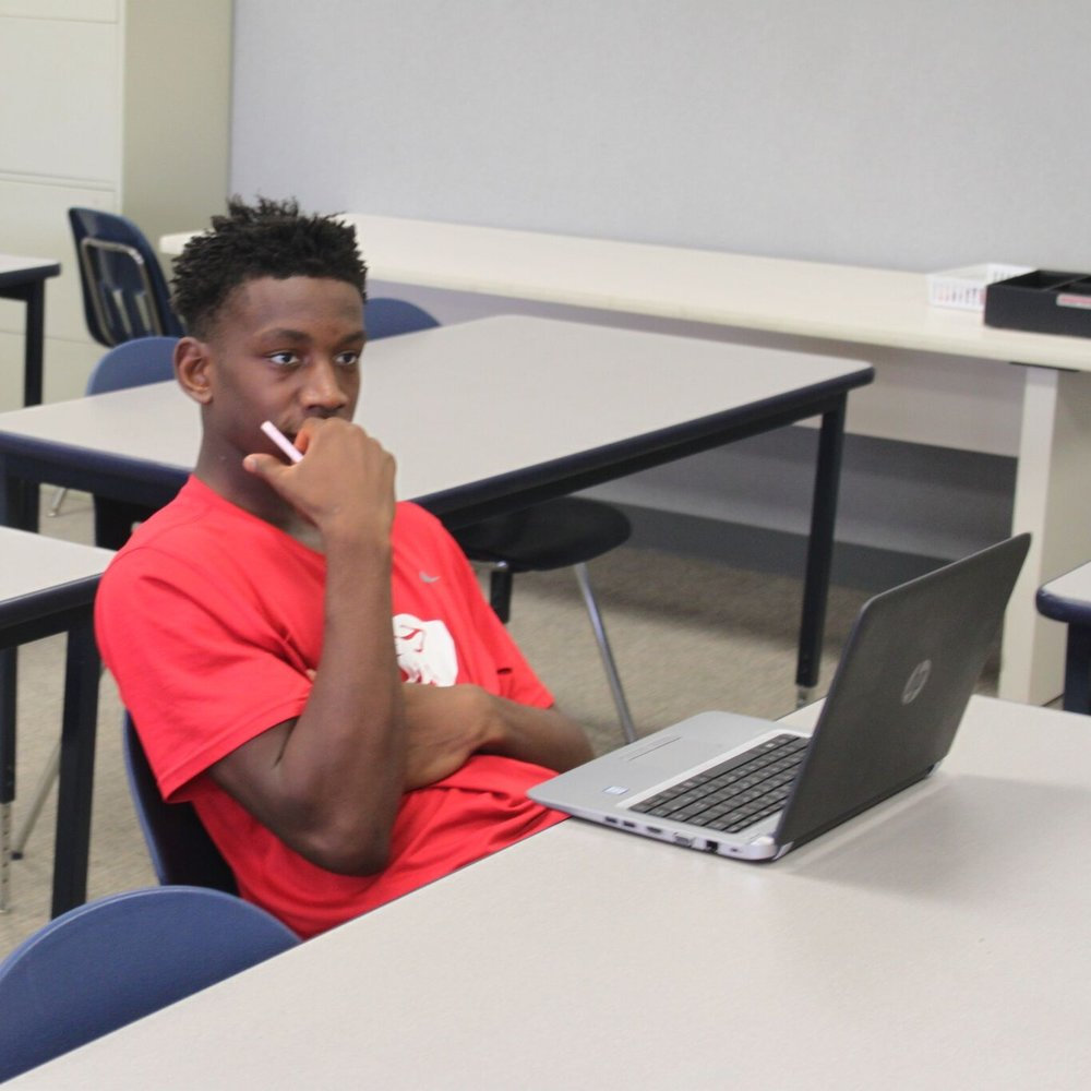 A high school student listens during one of his in-class sessions for ParishVirtual.