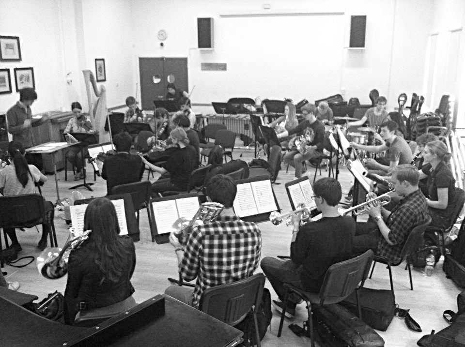 Jude conducting the RCM MT Orchestra in rehearsal (Durrington Room, London)