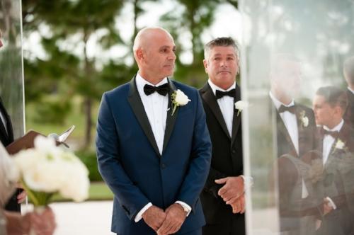 lisa stoner events- waldorf astoria wedding ceremony- wedding ceremony- groom-navy blue tuxedo- orlando wedding.jpg