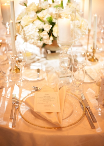 Lisa Stoner Events - Waldorf Astoria Orlando - orlando weddings - white centerpiece - clear glass charger.jpg