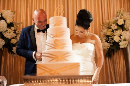 lisa stoner events- orlando destination weddings- waldorf astoria wedding- white wedding cake- cake cutting- bride- groom- blue tuxedo.jpg