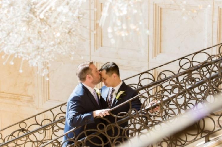 lisa stoner events- four seasons resort orlando- orlando luxury weddings- same sex weddings- central florida same sex weddings- kiss on the steps.jpg
