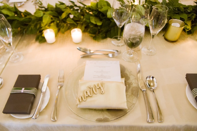 lisa stoner events- four seasons orlando- ivory linen - clear charger plates - luggage tag wedding favors - carved wood place cards.jpg