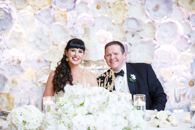 lisa stoner events- bride and groom- white paper flower wall- orlando luxury weddings- bride and groom.jpg