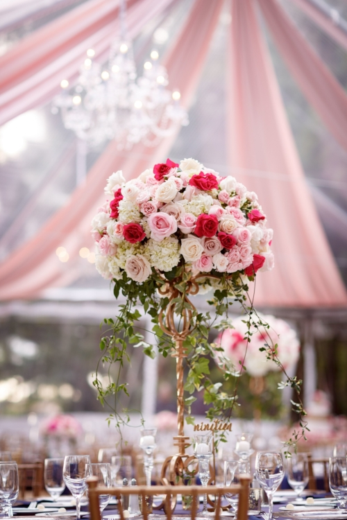 lisa stoner weddings- orlando luxury tented wedding planner- pink tent drape- pink and white tall centerpieces - tented wedding - orlando chic weddings.jpg