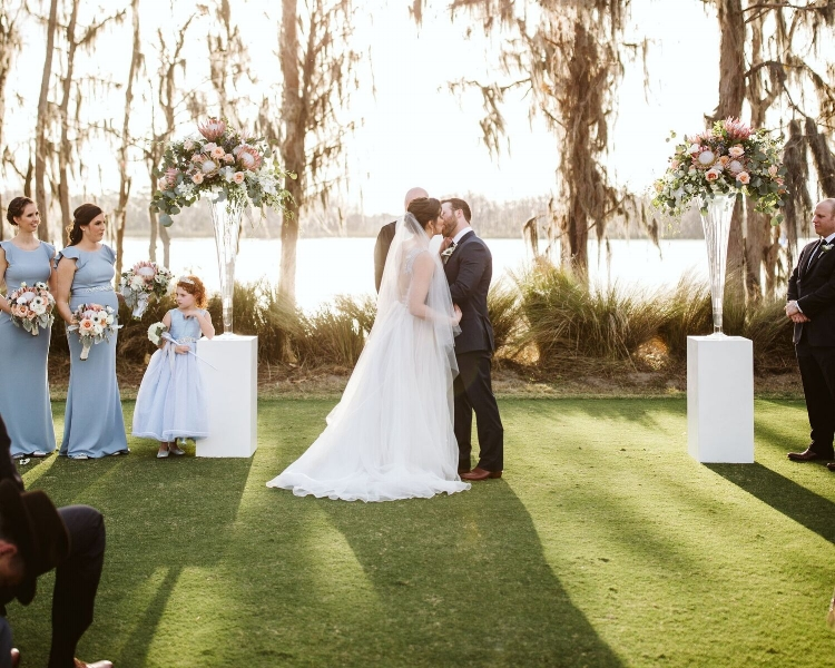 lisa stoner events - central florida outdoor wedding ceremony - elegant central florida outdoor wedding ceremony- flower girl - first kiss - luxury windermere wedding planner.jpg