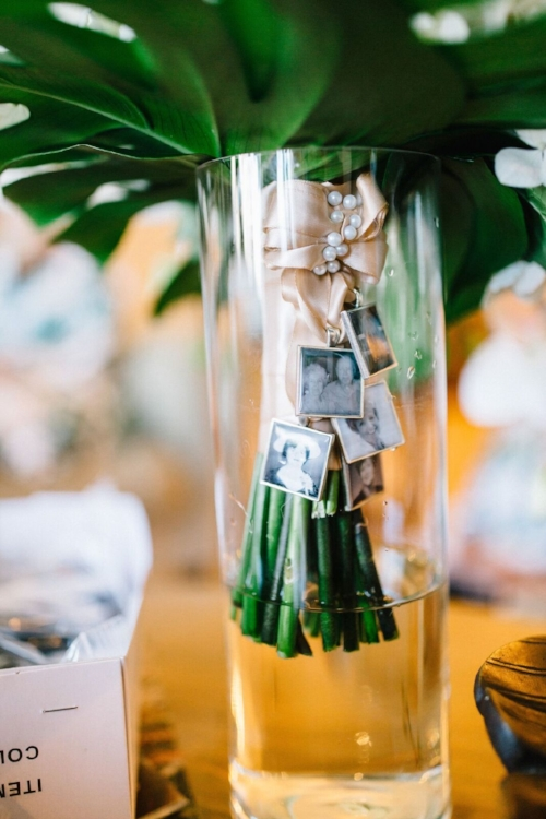lisa stoner event planning- palm coast luxury wedding planner - unique wedding bouquets- photo lockets on bridal bouquet- central florida high end wedding planner.jpg