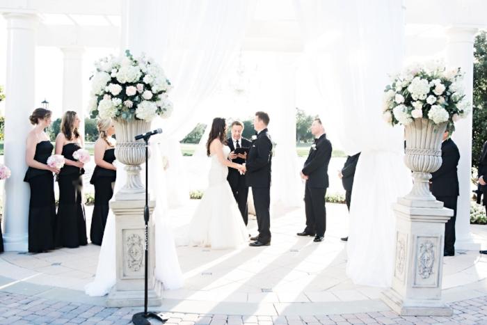 lisa stoner weddings - ritz carlton wedding gazebo in orlando- ritz carlton orlando outdoor wedding ceremony - orlando sunset wedding- white wedding ceremony flowers.jpg
