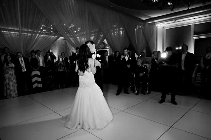 lisa stoner weddings- orlando luxury weddings- white dance floor- black and white wedding photography- draping for a wedding- first dance.jpg