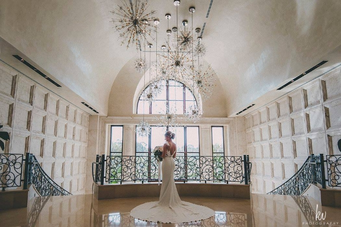 lisa stoner events- four seasons orlando at walt disney world resort - grand staircase - bride- wedding portraits - pronovias gowns.jpg