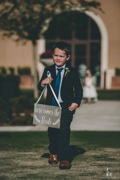 lisa stoner wedding - four seasons resorts - ring bearer - four seasons orlando outdoor wedding ceremony.jpg