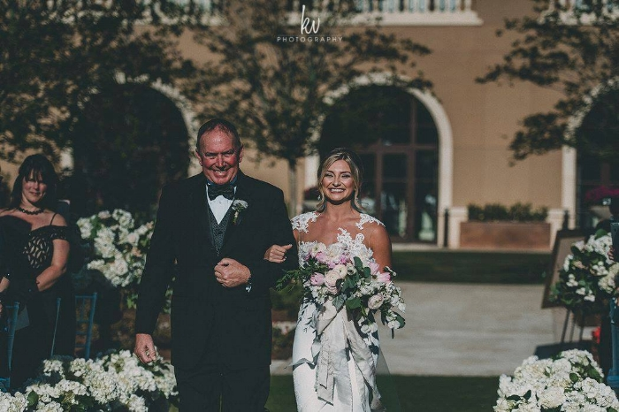 lisa stoner events- four seasons orlando - outdoor wedding ceremony- bride- bride's entrance - four seasons wedding ceremony.jpg